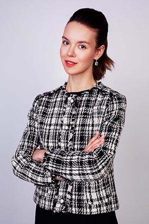 Woman in plaid jacket crossed her arms