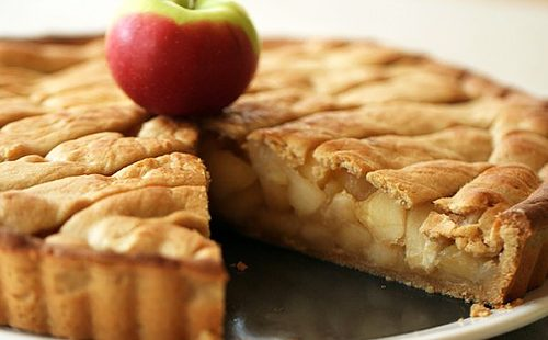 A simple cake decorated with apples