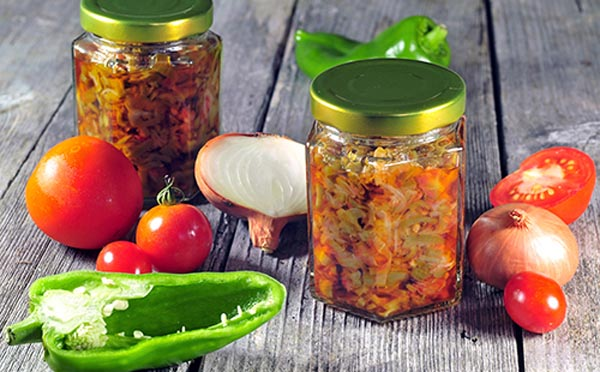 Canned tomatoes, peppers and onions in a jar