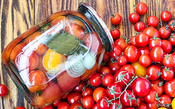 Marinated tomatoes with onions in a jar